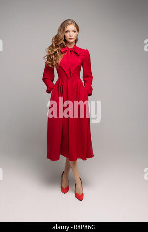 Stunning Slim Model In Bright Red Dress And Black Heels Stock Photo