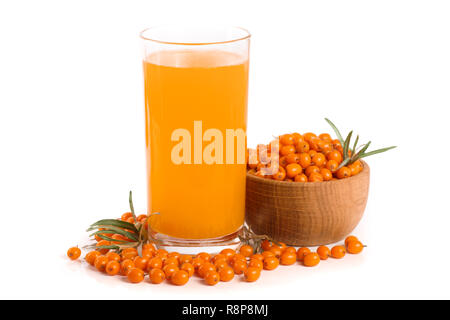 Sea buckthorn juice in a glass and wooden bowl with berries isolated on white background - Stock Photo