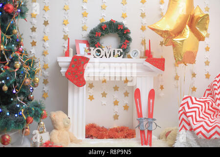 close up.Christmas tree and stylized fireplace in the living room on Christmas eve - Stock Photo