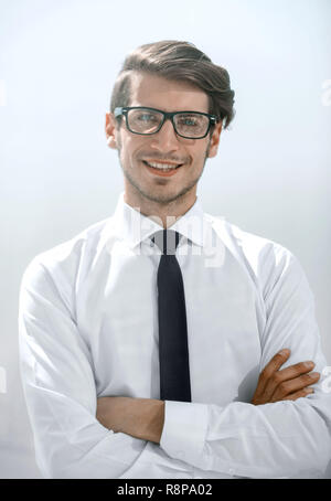 successful young businessman on a bright background - Stock Photo