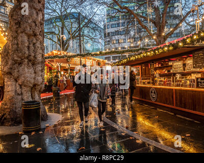 Stalls at Leicester Square Christmas Market, London, UK. - Stock Photo
