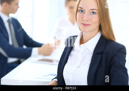 Group of business people or lawyers discussing terms of transaction in office. Focus at young business woman. Meeting and teamwork concept