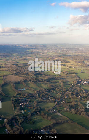 Vertical aerial view across the Surrey countryside. - Stock Photo