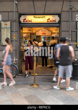Vertical view of a shop selling Panzerotti in Milan, Italy. - Stock Photo
