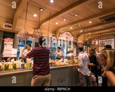 Horizontal view of people buying Panzerotti in Milan, Italy. - Stock Photo