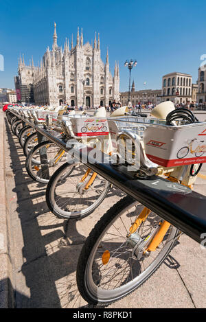Vertical view of bicycles for hire in Milan, Italy. - Stock Photo