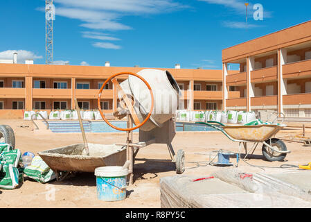 Unfinished property development under construction in new town of Gran Alacant close to Alicante, Costa Blanca, Spain - Stock Photo