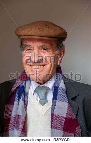 Portrait of smiling elderly man, Sassari, Sardinia, Italy - Stock Photo
