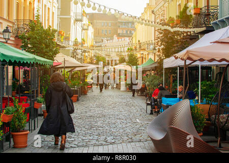 TBILISI, GEORGIA - NOV 01 2018: People walking on reconstructed street David Agmashenebeli with lot of new restaurants and cafes - Stock Photo
