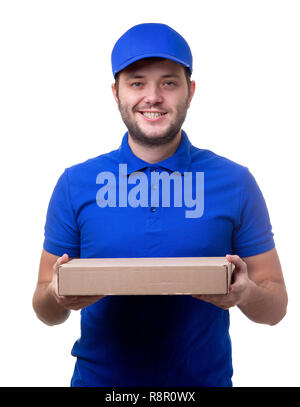 Photo of man in blue T-shirt and baseball cap with cardboard box for pizza on white blank background - Stock Photo