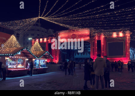 13 DEC 2018, Romania, Bucharest. Christmas stage at Christmas Market at Romanian Parliament. Long exposure image - Stock Photo