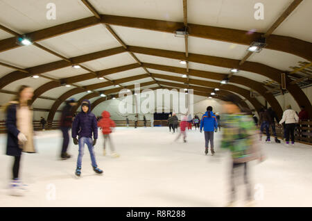 Nis, Serbia, February 11, 2017:winter sport,indoor, blurred people on skating rink,motion, long exposure. People, friendship,sport and leisure concept - Stock Photo