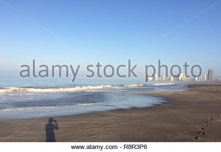 View over the beach on the buildings of the city of Iquique in chile - Stock Photo