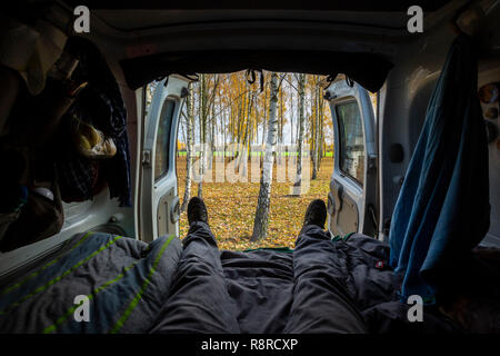 Van life backdoor view during a road trip in Poland. - Stock Photo
