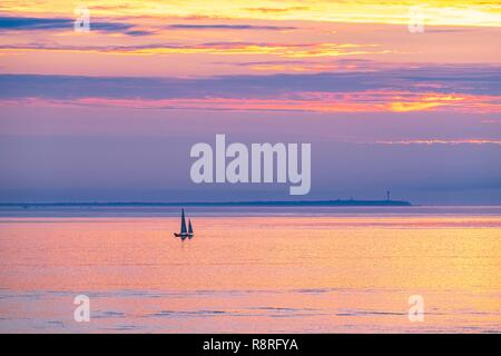 France, Finistere, Le Conquet, sunset from Kermorvan peninsula, Ouessant island in the background - Stock Photo