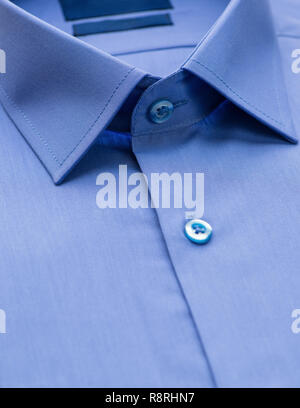 blue shirt with a focus on the collar and button, close-up - Stock Photo