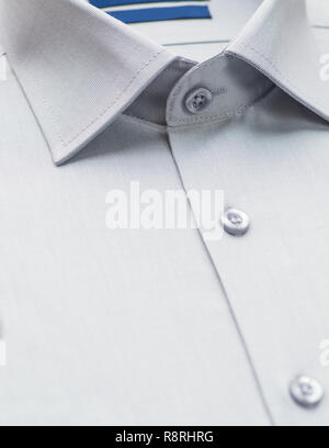 gray shirt with a focus on the collar and button, close-up - Stock Photo