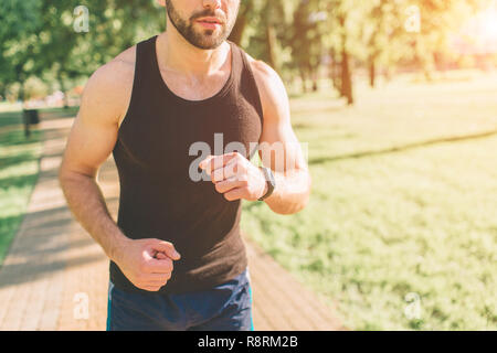 Picture of a young athletic man after training. handsome young muscular man drinks a protein. Attractive athletic shirtless sportasman drinking sports nutrition shake from blender. - Stock Photo