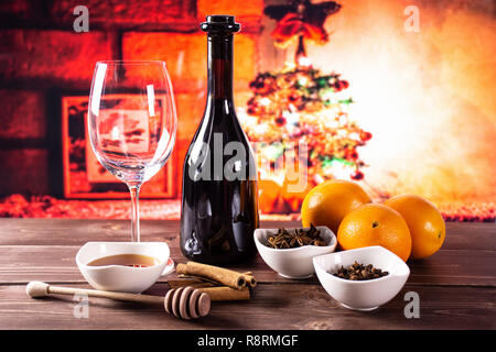 Ingredients. recipe step by step hot red mulled wine with christmas tree in red background - Stock Photo