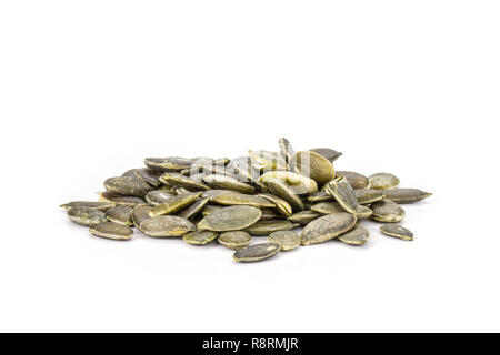 Lot of whole hulled pumpkin seeds heap isolated on white background - Stock Photo