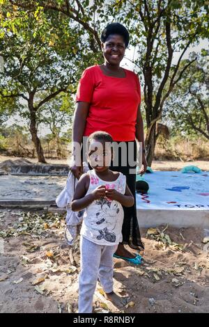 African mother and Daughter in school, Lake Kariba, Zambia. - Stock Photo