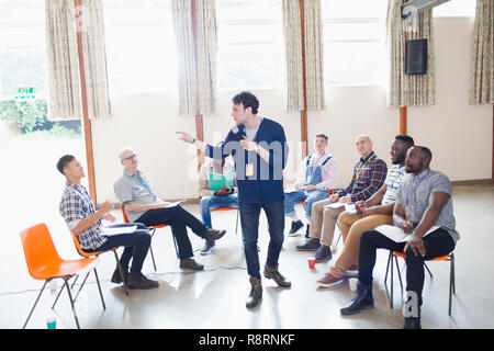 Man talking, leading group therapy - Stock Photo