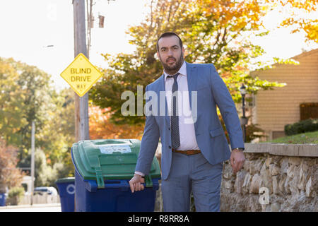 Businessman with Visual Impairment taking in the trash - Stock Photo