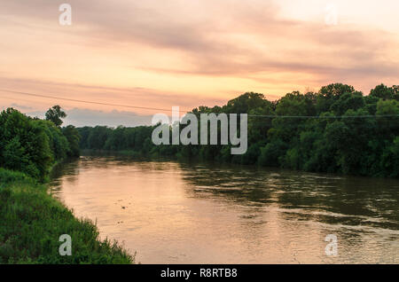 The sun sets over the Yazoo River in Greenwood, Mississippi. - Stock Photo
