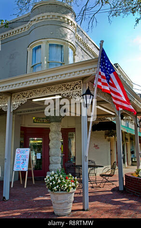 An American flag flies outside Tyson Drug Co. Sept. 25, 2011 in Holly Springs, Mississippi. The store sells old-fashioned milkshakes. - Stock Photo