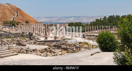 panorama of the ancient roman city in beit shean national park with tel beit shean and the jordan valley in the background - Stock Photo