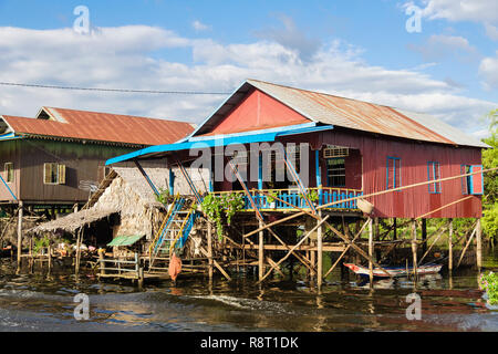 Houses on stilts in floating village in Tonle Sap freshwater lake. Kampong Phluk, Siem Reap, Cambodia, Indochina, southeast Asia - Stock Photo