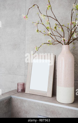 Home decor, neutral vases with empty frame against grey wall modern decoration - Stock Photo