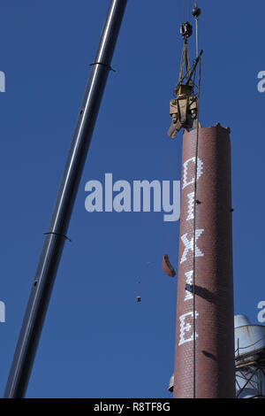 Lexington, North Carolina, USA. 17th December, 2018. Dixie Smokestack demolition. Lexington, NC. Lexington Home Brands Plant No. 1 smoke stack being domolished after fire destroyed the once prosperous manufacturing plant. The smokestack is on Norfolk-Southern right-of-way.  The smokestak was a landmark and reminder to a once thriving furniture industry in the area and it was not practical to preserve. Credit: Patrick Lynch/Alamy Live News - Stock Photo
