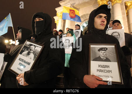 Kiev, Ukraine. 17th Dec, 2018. Protesters are seen holding portraits of Ukrainians captured and imprisoned by Russians during the rally.Ukrainians held the rally in support of the 24 Ukrainian navy sailors who were seized by the Russians during the Kerch Strait incident on 25 November 2018, and other Ukrainian political prisoners in Russia, Crime and the conflict zone of the East of Ukraine. Credit: ZUMA Press, Inc./Alamy Live News - Stock Photo