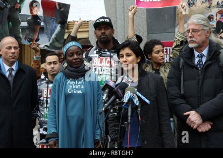 New York, NY, USA. 17th. Dec, 2018. Protester THERESE PATRICIA OKOUMOU, 44, who was charged with trespassing, disorderly conduct and interfering with government functions after partially climbing the Statue of Liberty monument on July 4, 2018, was found guilty on all charges in the U.S. Federal Court in lower Manhattan on 17 December 2018. The Congolese-born US naturalized-citizen, will be sentenced on 5 March 2019 and faces up to 6 months of jail on each of three different charges. Pictured is THERESE PATRICIA OKOUMOU and legal advisor Attorney MICHAEL AVENATTI, with defence Attorneys RON K - Stock Photo