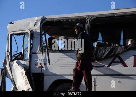 Kandahar. 17th Dec, 2018. Photo taken on Dec. 17, 2018 shows a damaged bus at the site of a traffic accident in Daman district of Kandahar province, Afghanistan. At least three people were killed and 40 others injured after a passenger bus collided with a truck coming from the opposite direction Monday afternoon. Credit: Sanaullah Seiam/Xinhua/Alamy Live News - Stock Photo