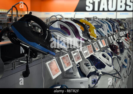 10 December 2018, North Rhine-Westphalia, Köln: Irons are available for viewing in a market of the retail chain 'Saturn'. Photo: Henning Kaiser/dpa - Stock Photo