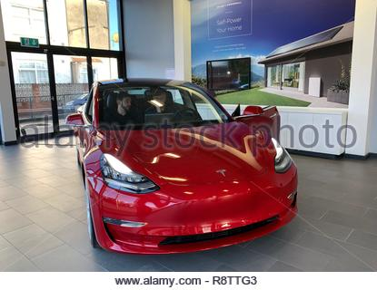 Manchester, UK. 17th December, 2018. The Tesla Model 3 car on display in red at the Manchester Tesla showroom, one of only two Model 3 cars in the UK, ahead of its European launch. ( Credit: David Rawcliffe/Alamy Live News - Stock Photo
