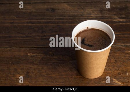 coffee to go in a disposable cup on a white background, space for text - Stock Photo