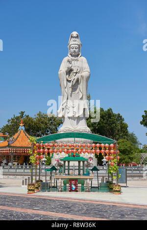 Very large statue of Buddhist goddess of mercy Guanyin, in Kuang Im Chapel, near River Kwai, in Kanchanaburi, Thailand. - Stock Photo