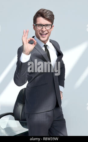 close up.smiling businessman showing OK gesture - Stock Photo