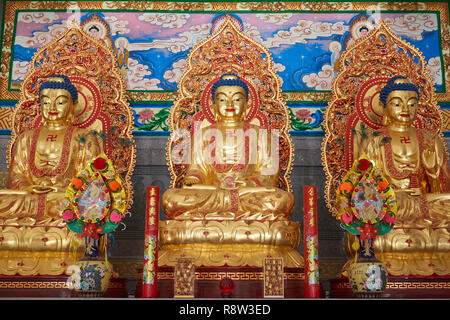 Detail of Gilt  Buddha inside Kuang Im Chapel, near River Kwai, Kanchanaburi, Thailand. - Stock Photo