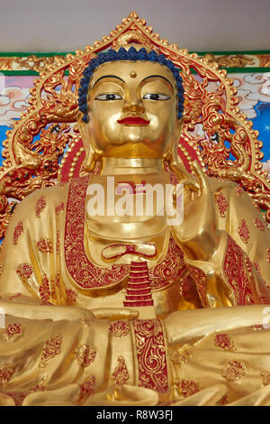 Detail of Gilt  Buddha inside Kuang Im Chapel, near River Kwai, Kanchanaburi, Thailand. - Stock Photo