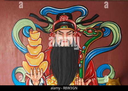 Detail of colourful door paintings inside Kuang Im Chapel, near River Kwai, Kanchanaburi, Thailand. - Stock Photo