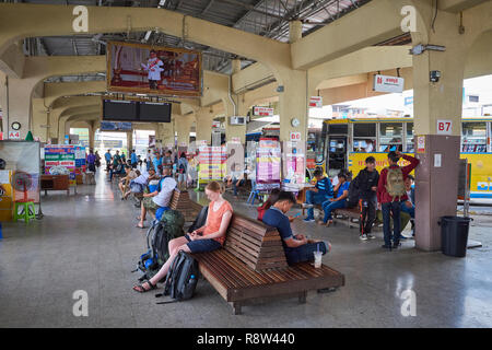 Passengers await in the departure area of  Kanchanaburi central bus terminal, in Thailand. - Stock Photo