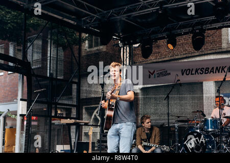 Germany, Muenster, October 5, 2018: Street rock concert on the main square of the city during the festive event. - Stock Photo