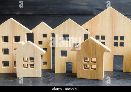 Wooden city and houses. concept of rising prices for housing or rent. Growing demand for housing and real estate. The growth of the city and its popul - Stock Photo