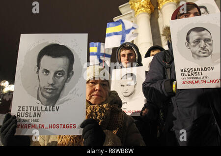 Protesters are seen holding portraits of Ukrainians captured and imprisoned by Russians during the rally. Ukrainians held the rally in support of the 24 Ukrainian navy sailors who were seized by the Russians during the Kerch Strait incident on 25 November 2018, and other Ukrainian political prisoners in Russia, Crime and the conflict zone of the East of Ukraine. On November 26 Ukrainian Parliament voted for accepting of the state of martial law for 30 days in 10 regions that border Russia, the Black Sea and the Azov Sea. - Stock Photo