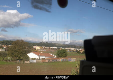 View from train car window outside of Barcelona Spain - Stock Photo