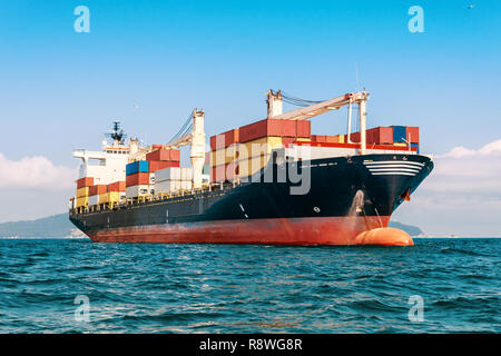 International Container Cargo ship in the ocean, Freight Transportation - Stock Photo